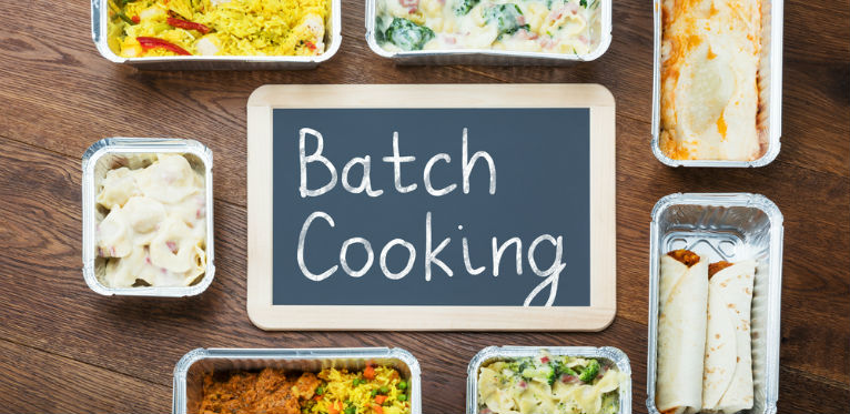 "A little picture with different kind of food. In the center there is a litlle sign with the text ""batch cooking"""